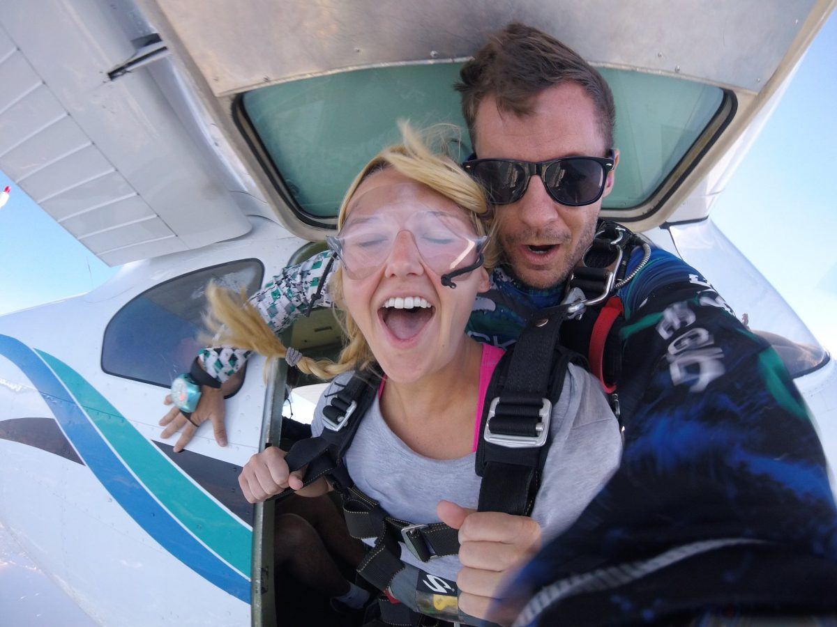 Girl jumping out of a plane at Skydive St Louis near Chicago