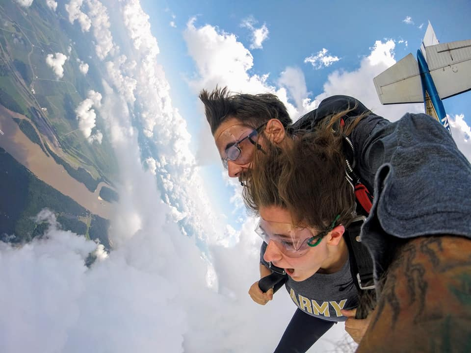 Girl tandem skydiving in freefall over Missouri at Skydive St Louis