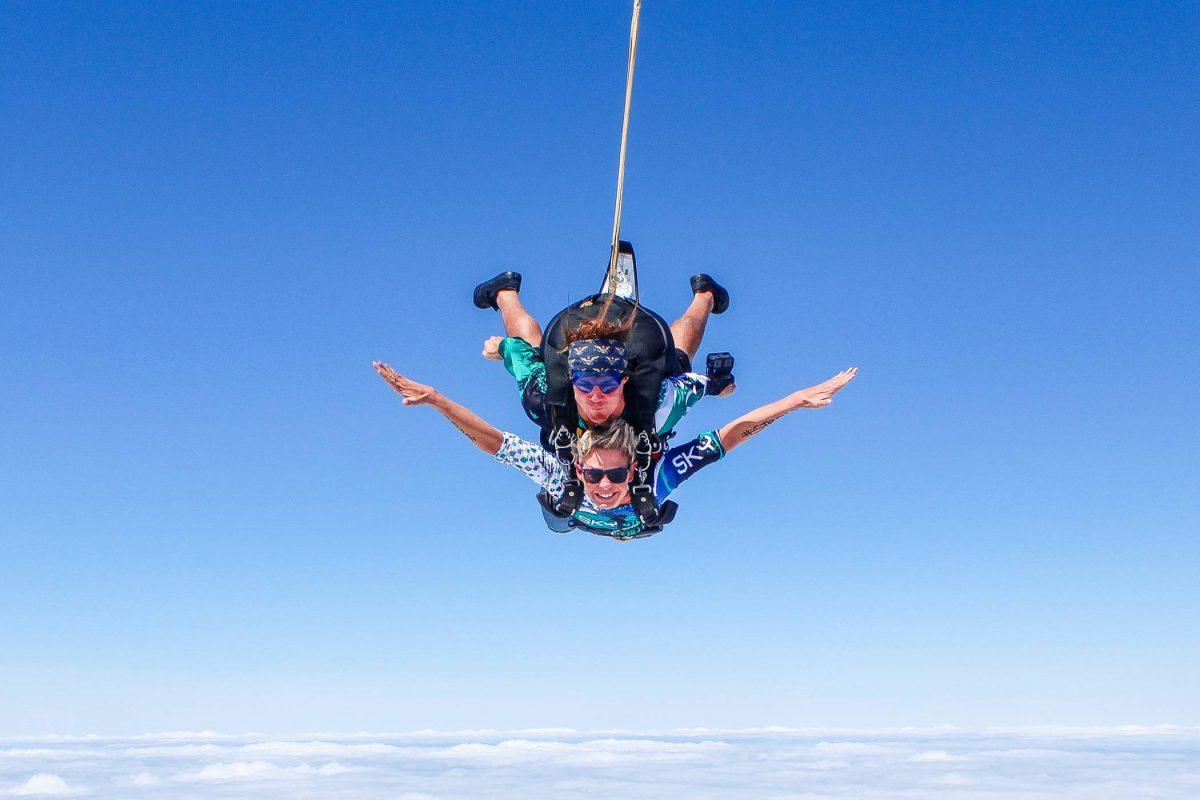 Woman skydiving tandem at high altitude at Skydive St. Louis