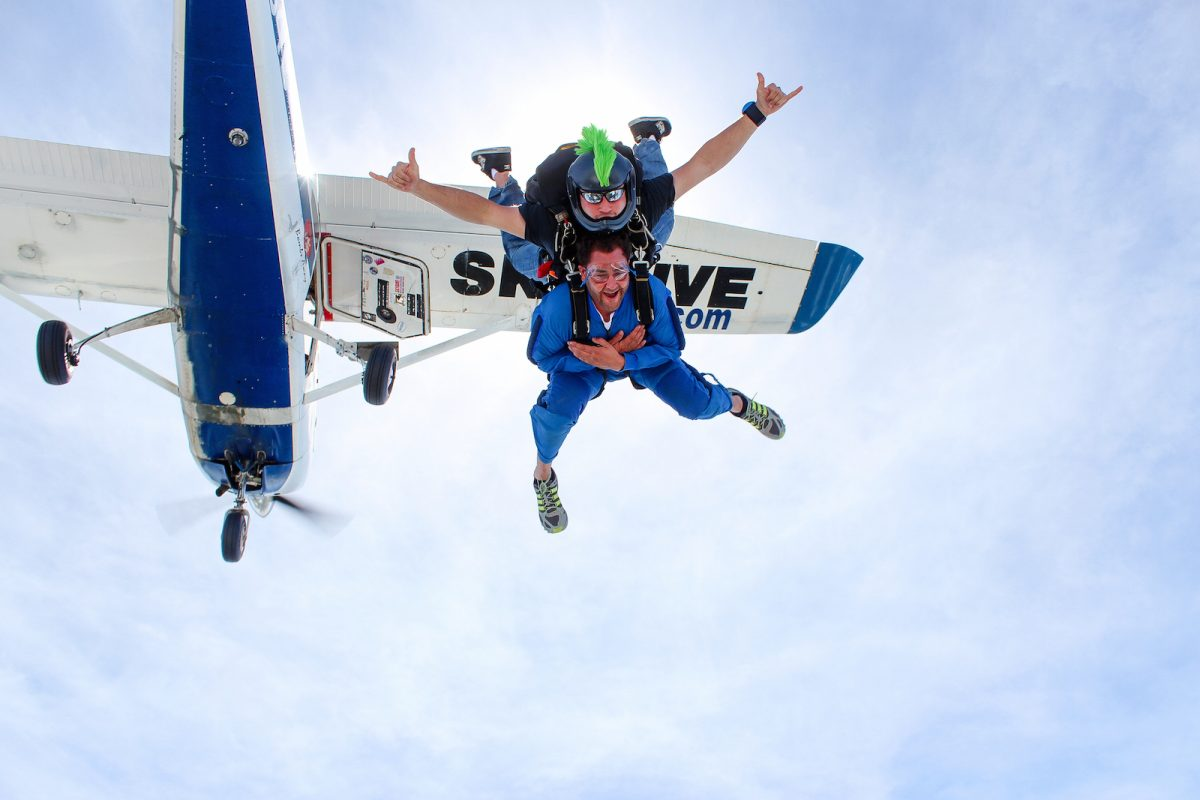 Man tandem skydiving for the first time at Skydive St Louis
