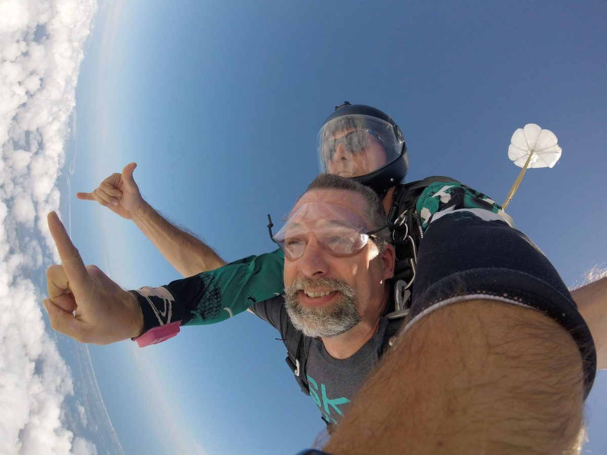 Man above the clouds while tandem skydiving at Skydive St Louis