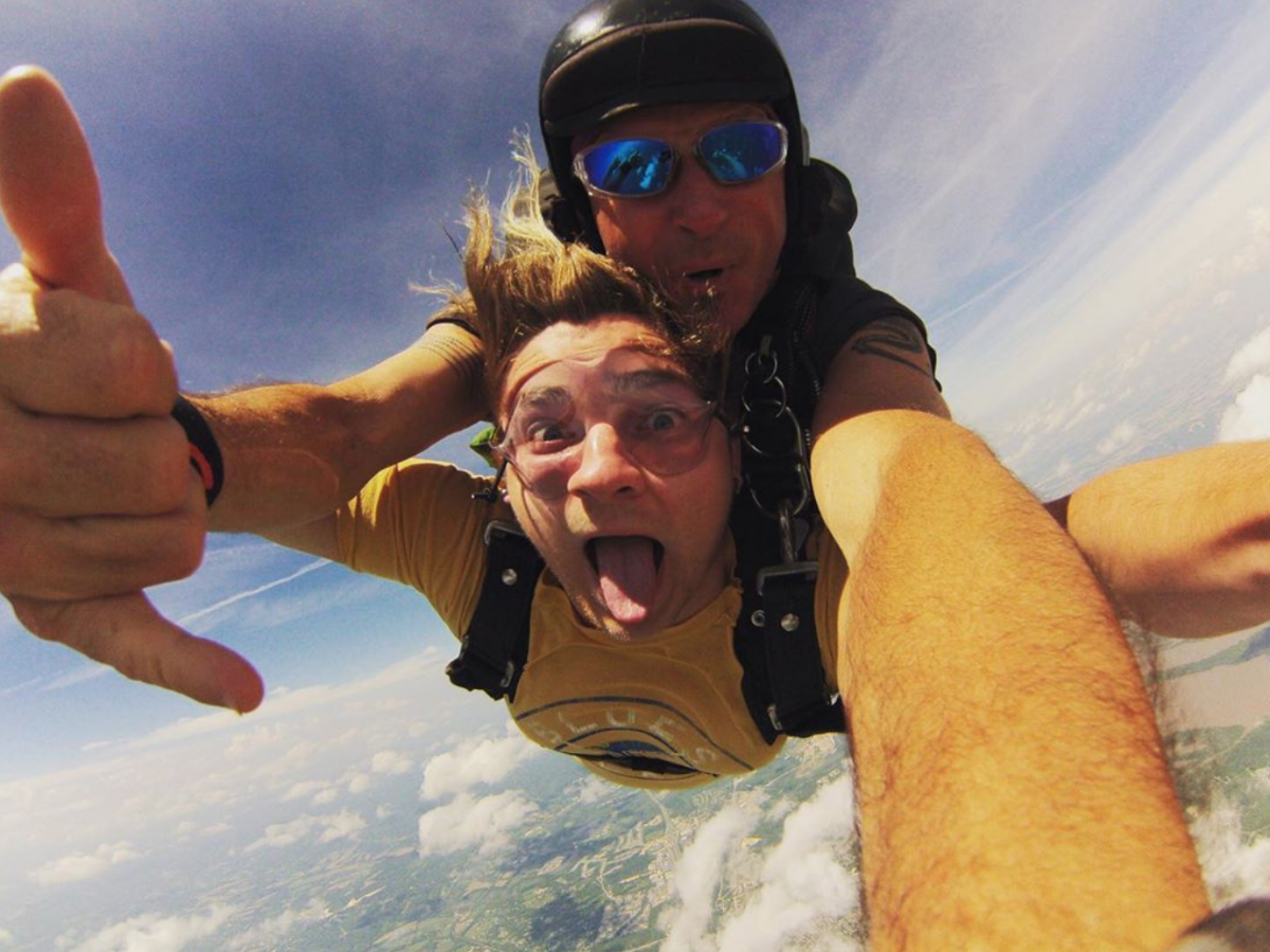 Man having the time of his life while tandem skydiving at Skydive St Louis