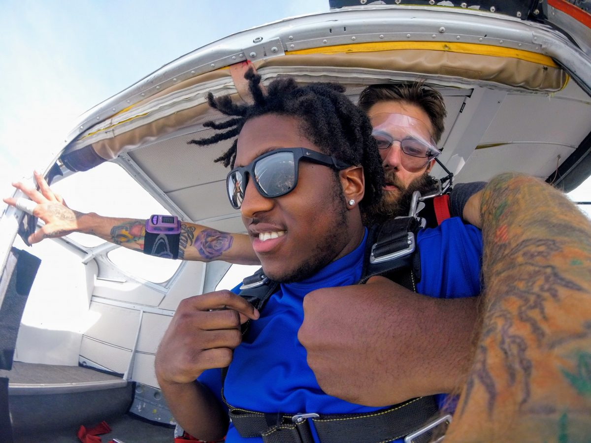 Man skydiving for the first time after receiving a skydiving gift certificate to Skydive St Louis near Chicago