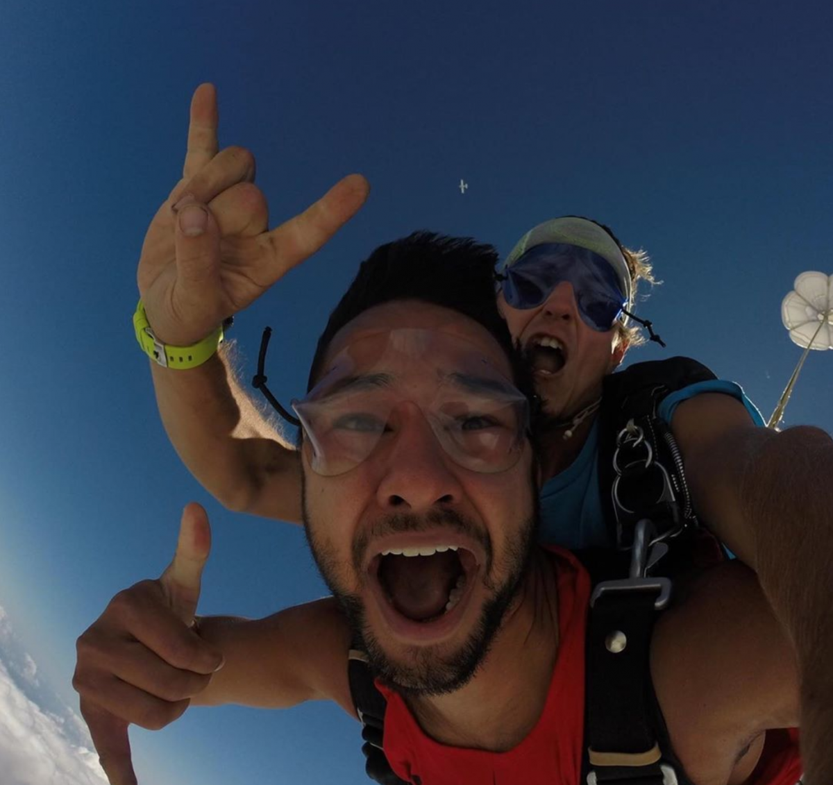 Man pumped as his parachute deploys while tandem skydiving at Skydive St Louis