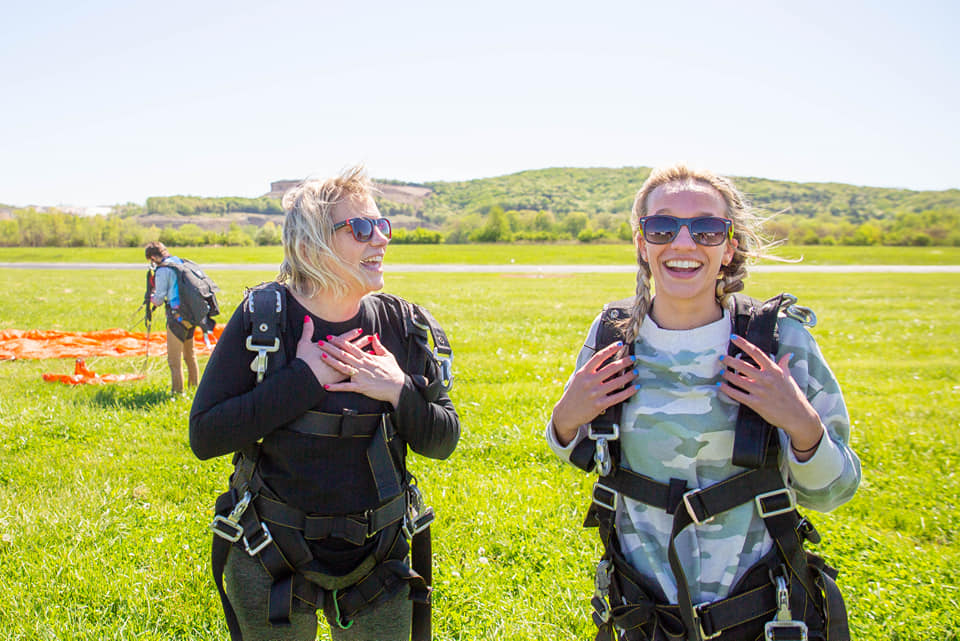 Mom and daughter smiling after their skydive at Skydive St. Louis near Chicago