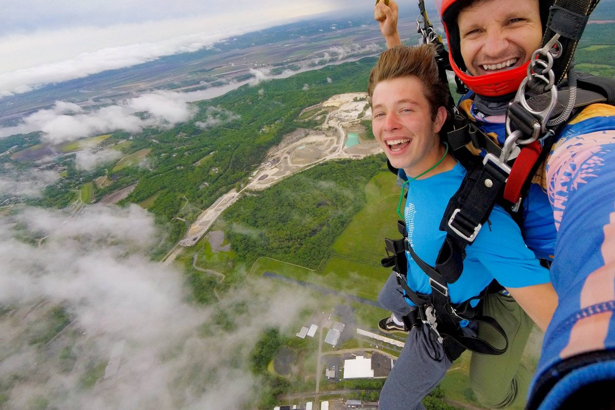 Tandem skydiver smiling while under parachute at Skydiving STL in St Louis