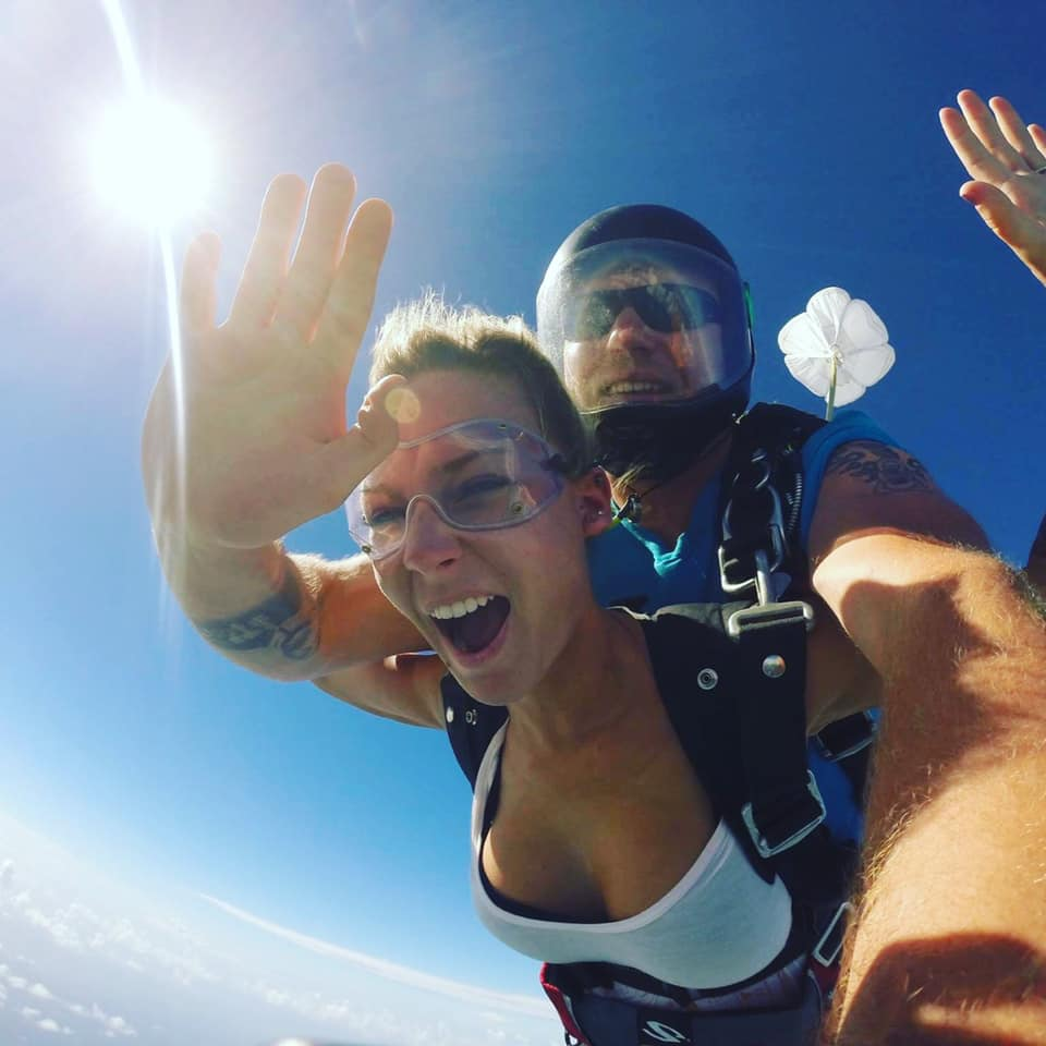 Woman excited to tandem skydive at Skydive St Louis