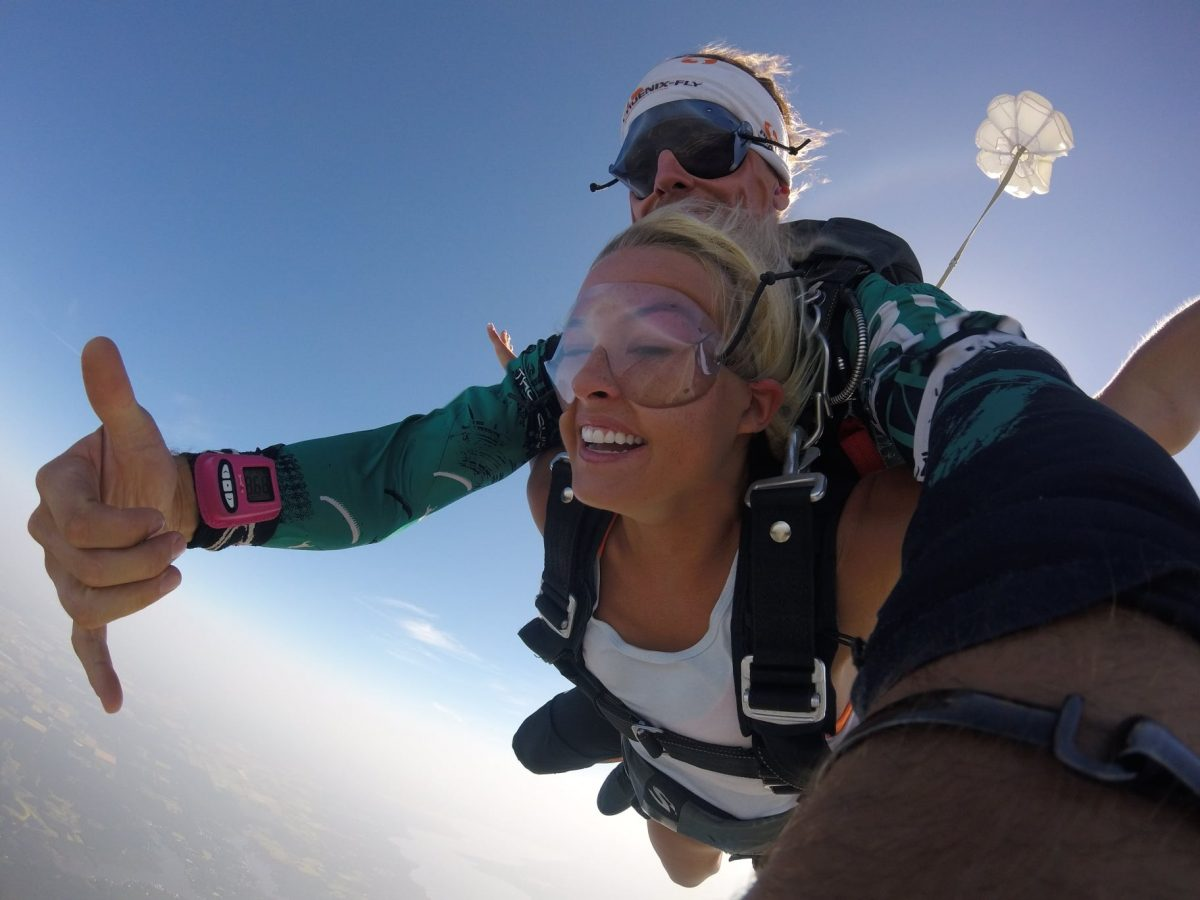 Woman euphoric with serotonin and dopamine while tandem skydiving at Skydive St Louis near Chicago