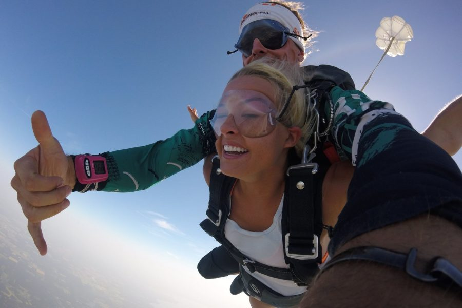 Woman smiling while tandem skydiving at Skydive St Louis in Missouri