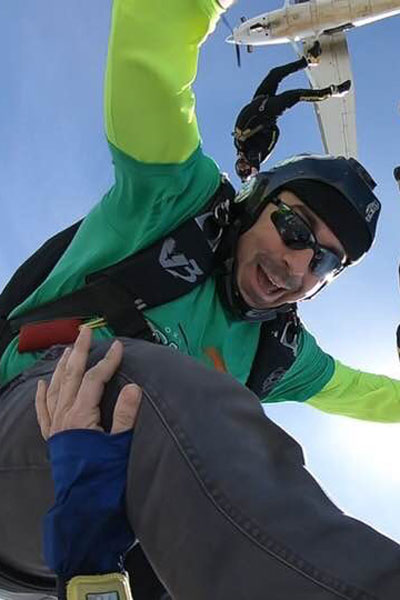 Jake Strain in freefall with other fun jumpers at Skydive STL