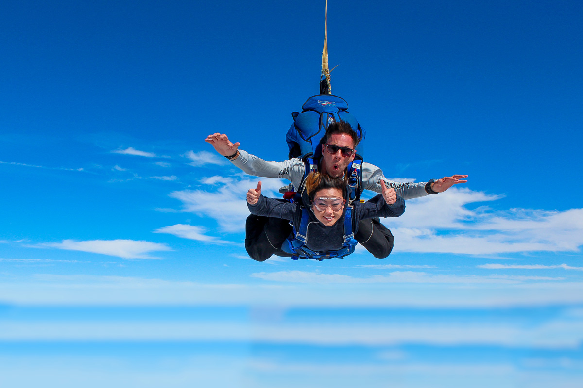 A woman's first-time tandem skydive with Skydive STL in St. Louis