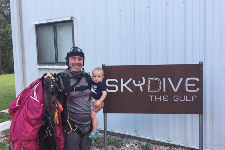 Jake Strain holding baby outside skydive the gulf